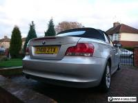 BMW 118i convertible. Silver with red leather seats