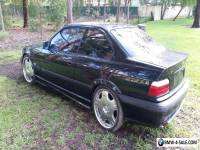 Two BMW E36's manual auto 318 328 Coupe Sedan