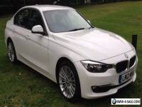 BMW 320d Luxury 4d Step Auto 3 series saloon in white 2012