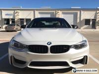 2015 BMW M4 Mineral White Exterior, Tan/Black/Carbon Fiber Int