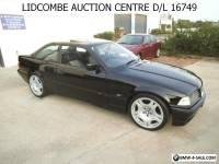 BMW 318 is COUPE 2 DOOR  126000KS BLACK WITH SUN ROOF